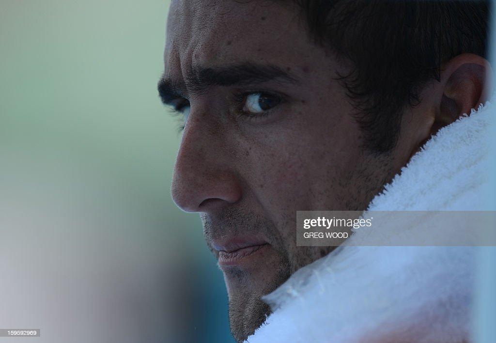 Croatia's Marin Cilic cools down with an ice pack during a break in his men's singles match against Rajeev Ram of the US on the fourth day of the Australian Open tennis tournament in Melbourne on J...