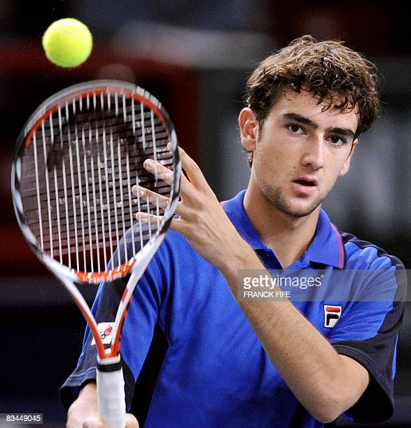 Croatia's Marin Cilic gets ready to serve to his Italian opponent Andreas Seppi during their ATP Paris Indoor Masters tounament first round tennis...