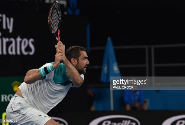 Croatia's Marin Cilic plays a backhand return to Ryan Harrison of the US during their men's singles third round match on day five of the Australian...