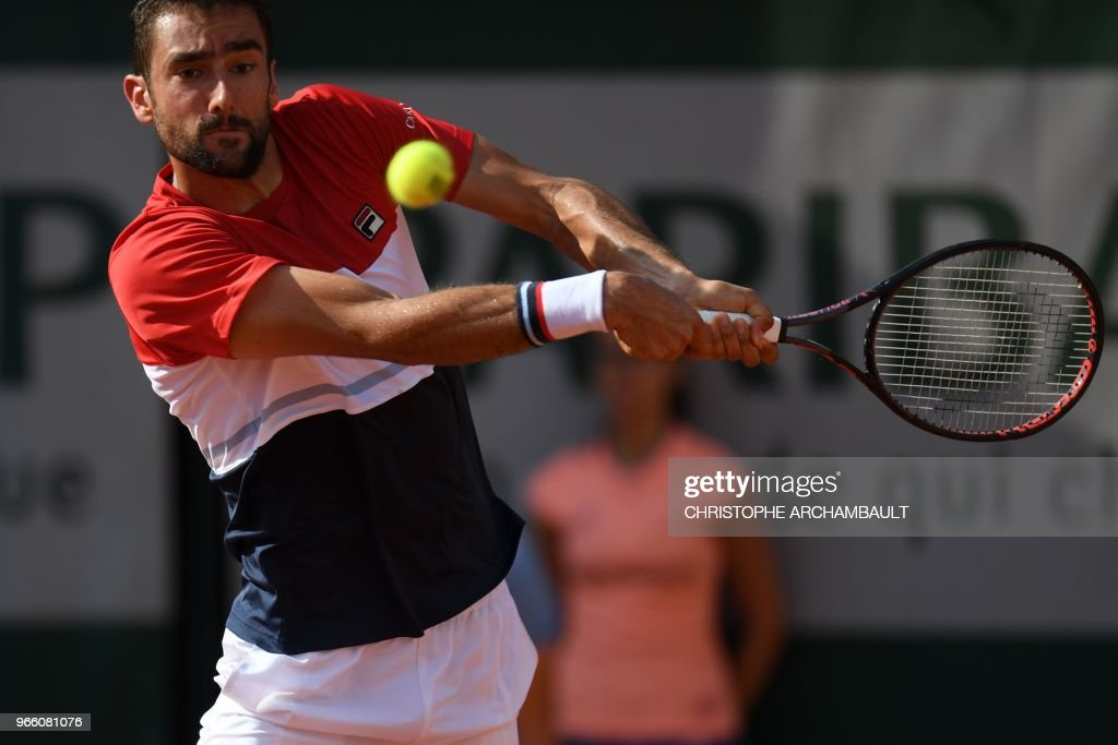 Croatia's Marin Cilic plays a backhand return to Steve Johnson of the US during their men's singles third round match on day seven of The Roland Garros 2018 French Open tennis tournament in Paris on June 2, 2018.