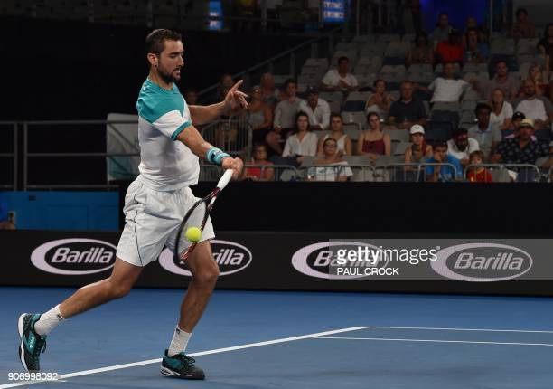 Croatia's Marin Cilic plays a forehand return to Ryan Harrison of the US during their men's singles third round match on day five of the Australian...