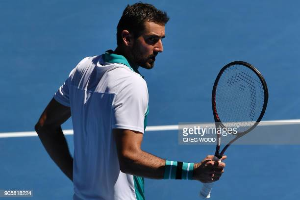 Croatia's Marin Cilic reacts after a point against Portugal's Joao Sousa during their men's singles second round match on day three of the Australian...