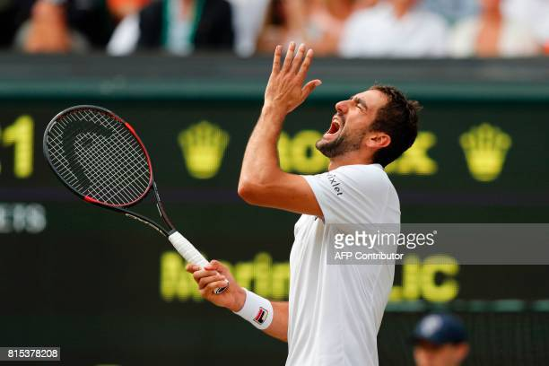 Croatia's Marin Cilic reacts after hitting the ball into the net against Switzerland's Roger Federer during their men's singles final match on the...