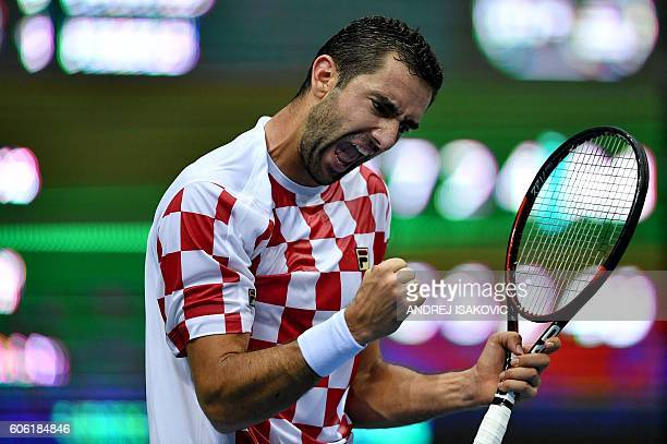 Croatia's Marin Cilic reacts after scoring against France's Lucas Pouille during the Davis Cup World Group semifinal singles tennis match between...