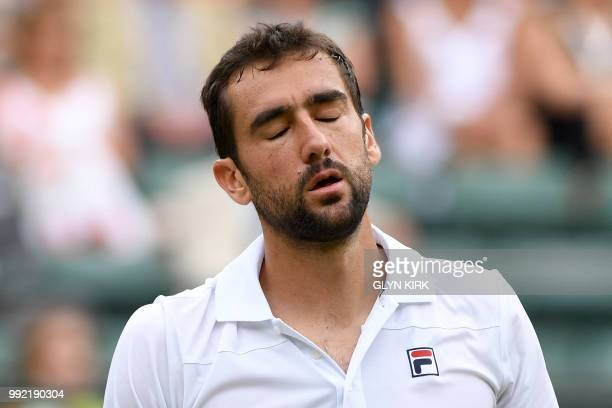Croatia's Marin Cilic reacts against Argentina's Guido Pella during their men's singles second round match on the fourth day of the 2018 Wimbledon...