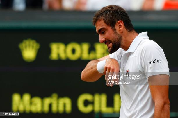 Croatia's Marin Cilic reacts against Switzerland's Roger Federer during their men's singles final match on the last day of the 2017 Wimbledon...