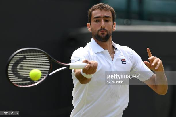 Croatia's Marin Cilic returns against Argentina's Guido Pella during their men's singles second round match on the fourth day of the 2018 Wimbledon...