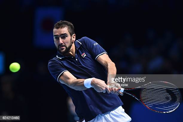Croatia's Marin Cilic returns against Japan's Kei Nishikori during their round robin stage men's singles match on day six of the ATP World Tour...