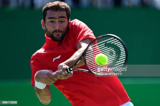 Croatia's Marin Cilic returns the ball to Bulgaria's Grigor Dimitrov during their men's first round singles tennis match at the Olympic Tennis Centre...