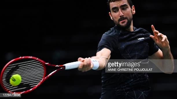 Croatia's Marin Cilic returns the ball to France's Ugo Humbert during their men's singles round of sixteen tennis match on day 4 at the ATP World...