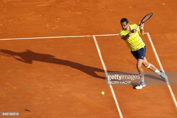 Croatia's Marin Cilic returns the ball to Spain's Fernando Verdasco during their round of 32 tennis match at the MonteCarlo ATP Masters Series...