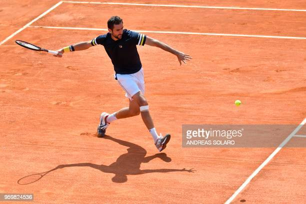 TOPSHOT Croatia's Marin Cilic returns the ball to Spain's Pablo Carreno Busta during their quarter final match at Rome's ATP Tennis Open tournament...