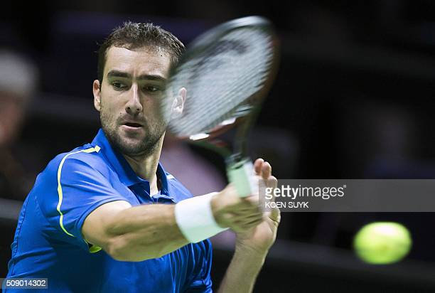 Croatia's Marin Cilic returns the ball to Uzbekistan's Denis Istominduring the first round of the ABN AMRO World Tennis Tournament on February 8 2016...