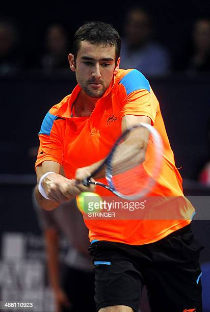 Croatia's Marin Cilic returns to Germany's Tommy Haas in their final match of the Croatian ATP PBZ Indoors tennis tournament in Zagreb on February 9...