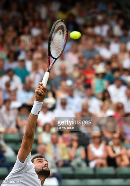 Croatia's Marin Cilic serves against Argentina's Guido Pella during their men's singles second round match on the fourth day of the 2018 Wimbledon...