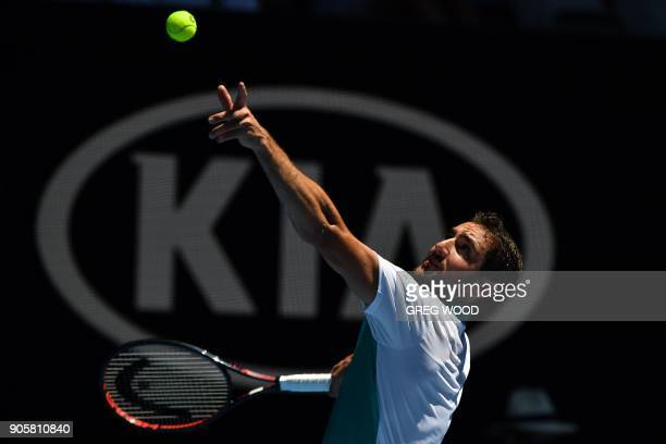 Croatia's Marin Cilic serves against Portugal's Joao Sousa during their men's singles second round match on day three of the Australian Open tennis...