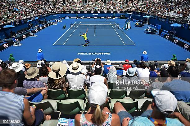 TOPSHOT Croatia's Marin Cilic serves against the Netherland's Mothiest de Bakker during their men's singles match on day one of the 2016 Australian...