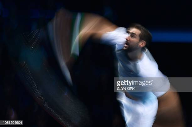 Croatia's Marin Cilic serves against US player John Isner during their men's singles roundrobin match on day four of the ATP World Tour Finals tennis...