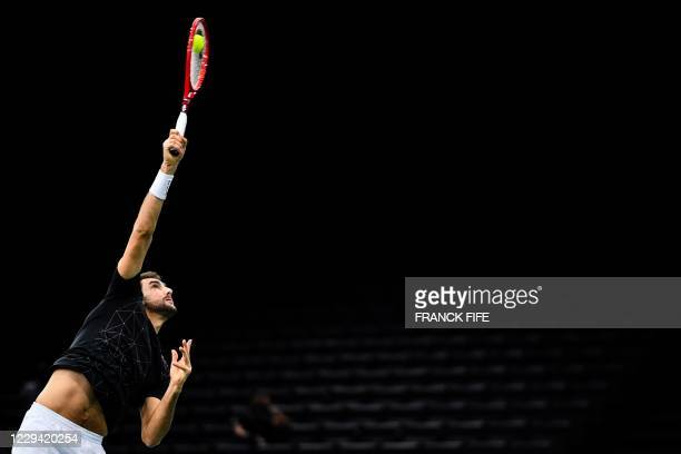 TOPSHOT Croatia's Marin Cilic serves the ball to Canada's Felix AugerAliassime during their men's singles first round tennis match on day 1 at the...