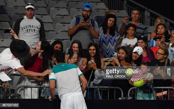 Croatia's Marin Cilic takes a selfie with a fan after beating Ryan Harrison of the US in their men's singles third round match on day five of the...