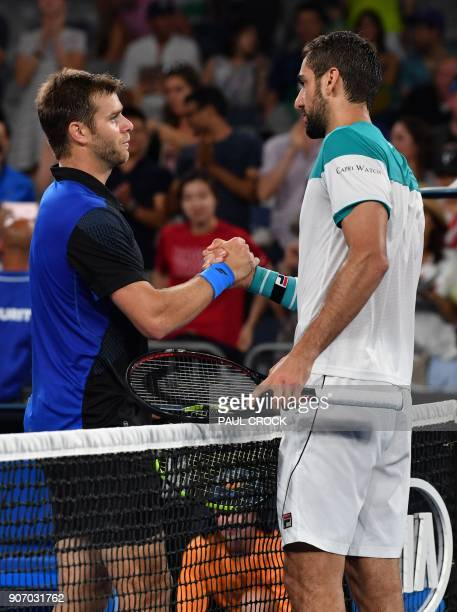 Croatia's Marin Cilic talks to Ryan Harrison of the US after their men's singles third round match on day five of the Australian Open tennis...
