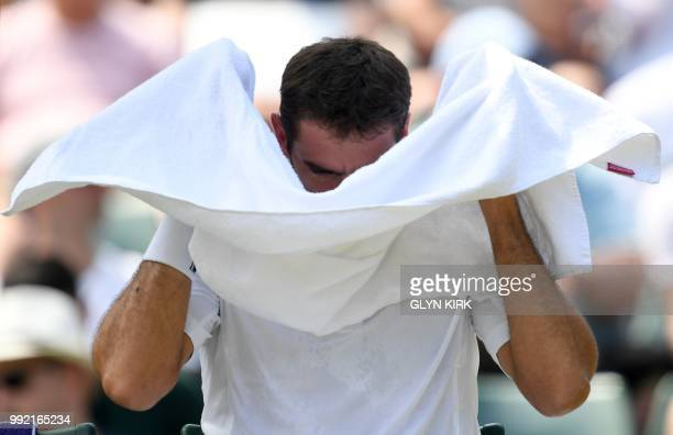 Croatia's Marin Cilic uses a towel during a break in play against Argentina's Guido Pella during their men's singles second round match on the fourth...