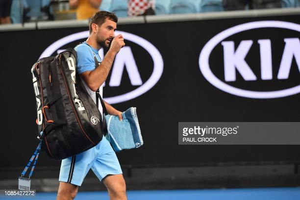 Croatia's Marin Cilic walks off the court after losing to Spain's Roberto Bautista Agut during their men's singles match on day seven of the...
