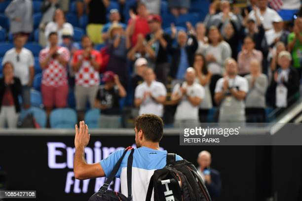 Croatia's Marin Cilic waves to the crowd after his defeat against Spain's Roberto Bautista Agut during their men's singles match on day seven of the...