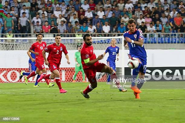 Croatia's Mario Manduki and Azerbaijan's Rashad Sadigov struggle for the ball during the Euro 2016 Group H qualifying soccer match between Azerbaijan...