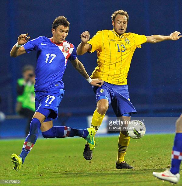 Croatia's Mario Mandzukic vies with Sweden's Andreas Grandqvist during their friendly football match between Croatia and Sweden in Zagreb on February...