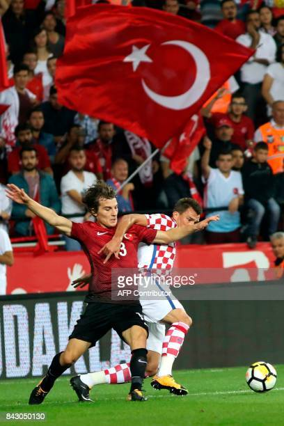 Croatia's Mario Mandzukic vies with Turkey's Caglar Soyuncu during the FIFA World Cup 2018 qualification Group I football match between Turkey and...