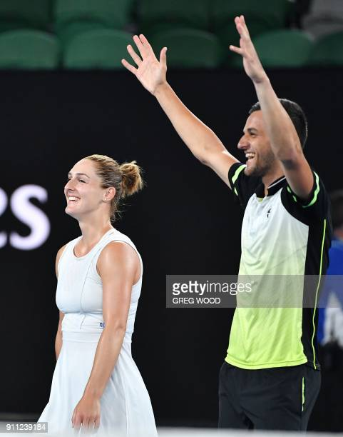 Croatia's Mate Pavic and Canada's Gabriela Dabrowski celebrate beating Hungary's Timea Babos and India's Rohan Bopanna in their mixed doubles final...