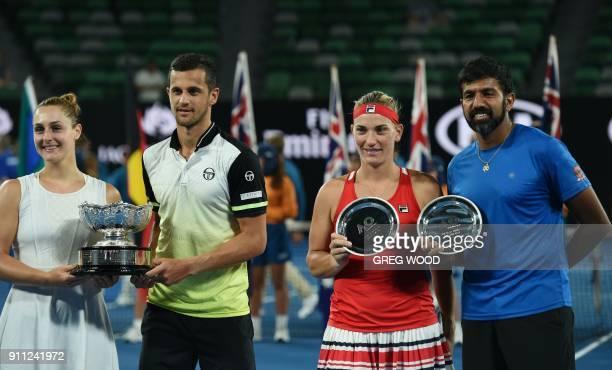 Croatia's Mate Pavic and Canada's Gabriela Dabrowski pose with the winners' trophy beside runnersup Hungary's Timea Babos and India's Rohan Bopanna...