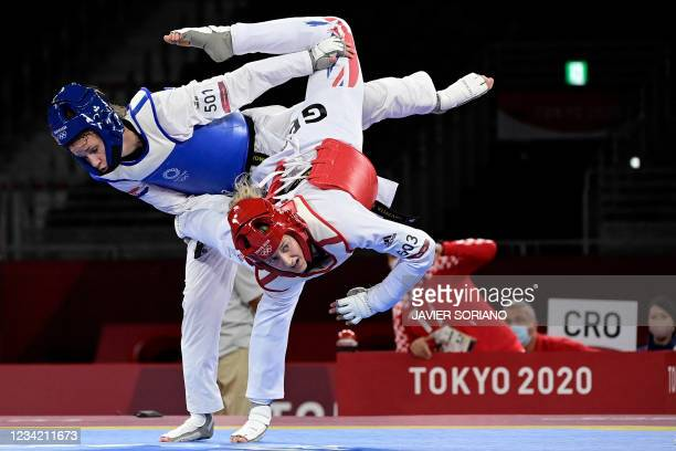 Croatia's Matea Jelic and Britain's Lauren Williams compete in the taekwondo women's -67kg gold medal bout during the Tokyo 2020 Olympic Games at the...
