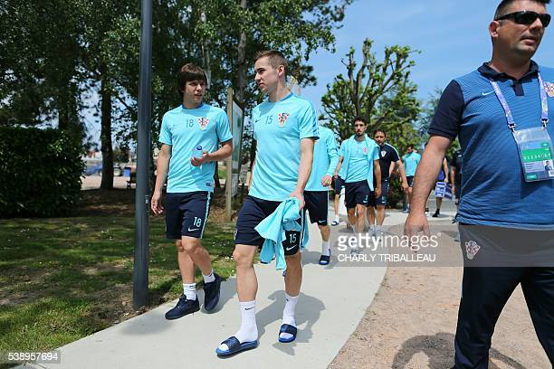 Croatia's midfielder Ante Coric Croatia's midfielder Marko Rog arrive to take part in a training session in Deauville northwestern France on June 9...