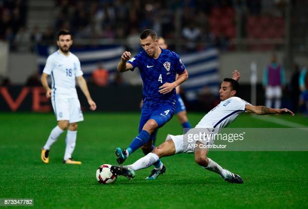 Croatia's midfielder Ivan Perisic and Greece's Brazilian defender Zeca vie for the ball during the World Cup 2018 playoff football match between...