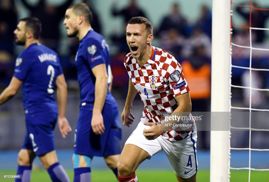 TOPSHOT - Croatia's midfielder Ivan Perisic (C) celebrates after soring a goal during the WC 2018 play-off football qualification match between Croatia and Greece at the Maksimir stadium, in Zagreb, on November 9, 2017. /