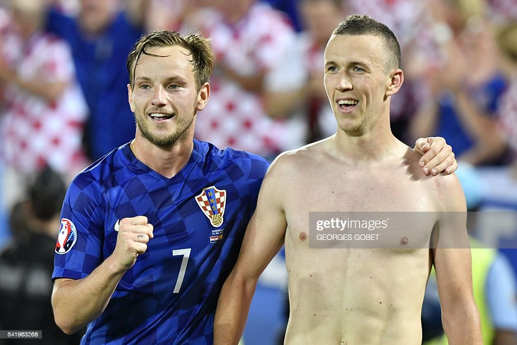 Croatia's midfielder Ivan Perisic (R) celebrates his goal, and his team's second, with Croatia's midfielder Ivan Rakitic (L) during the Euro 2016 group D football match between Croatia and Spain at the Matmut Atlantique stadium in Bordeaux on June 21, 2016. / AFP / GEORGES