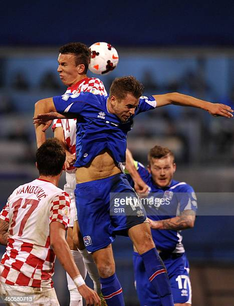 Croatia's midfielder Ivan Perisic vies with Iceland's defender Kari Arnason during the World Cup 2014 qualification playoff football match at...