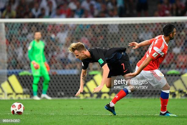 TOPSHOT Croatia's midfielder Ivan Rakitic and Russia's midfielder Alexander Samedov vie for the ball during the Russia 2018 World Cup quarterfinal...