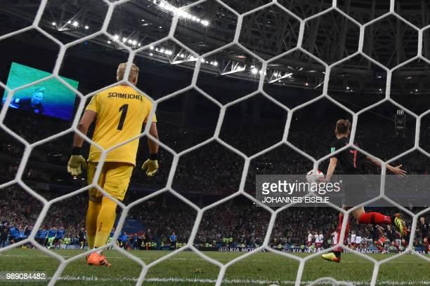Croatia's midfielder Ivan Rakitic celebrates after scoring the winning penalty against Denmark's goalkeeper Kasper Schmeichel during the penalty...