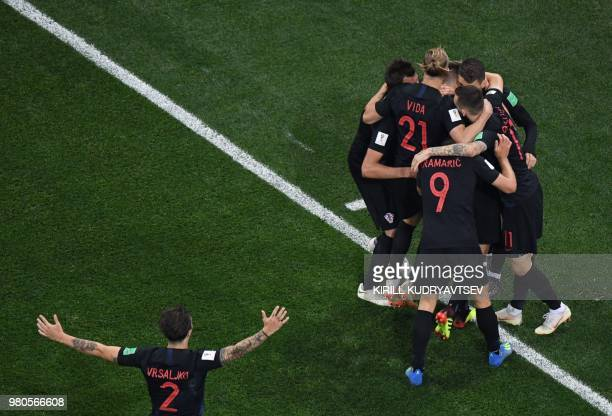 TOPSHOT Croatia's midfielder Ivan Rakitic celebrates with teammates after scoring during the Russia 2018 World Cup Group D football match between...