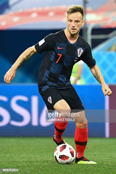 Croatia's midfielder Ivan Rakitic controls the ball during the Russia 2018 World Cup round of 16 football match between Croatia and Denmark at the...
