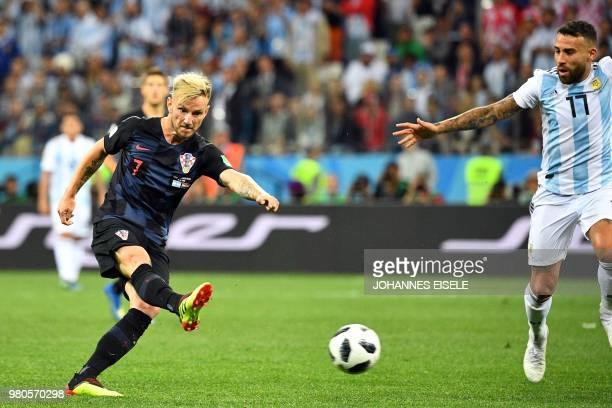 Croatia's midfielder Ivan Rakitic kicks the ball past Argentina's defender Nicolas Otamendi during the Russia 2018 World Cup Group D football match...