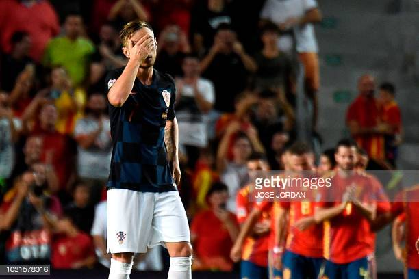Croatia's midfielder Ivan Rakitic reacts after Spain scored a goal during the UEFA Nations League A group 4 football match between Spain and Croatia...