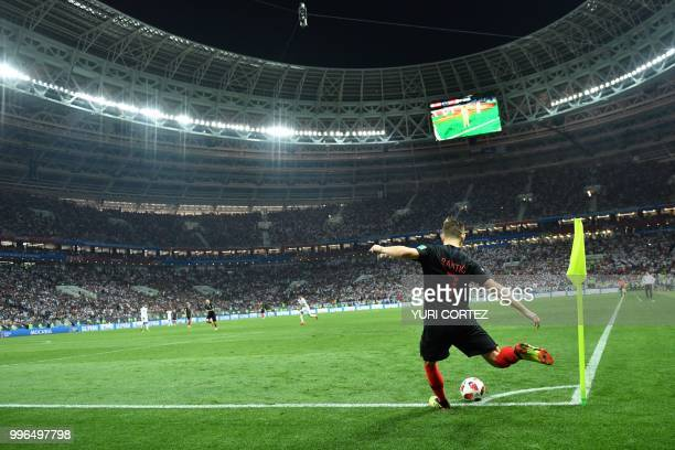 Croatia's midfielder Ivan Rakitic takes a corner kick during the Russia 2018 World Cup semifinal football match between Croatia and England at the...
