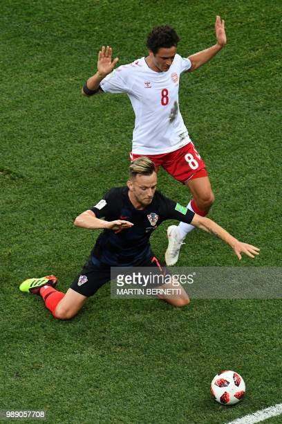 Croatia's midfielder Ivan Rakitic vies with Denmark's midfielder Thomas Delaney during the Russia 2018 World Cup round of 16 football match between...