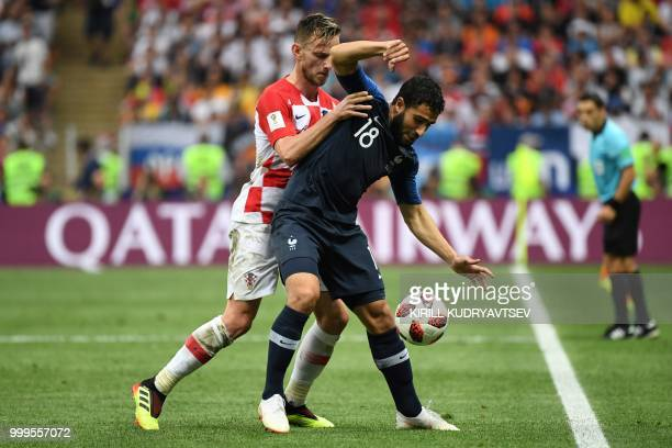 Croatia's midfielder Ivan Rakitic vies with France's midfielder Nabil Fekir during the Russia 2018 World Cup final football match between France and...
