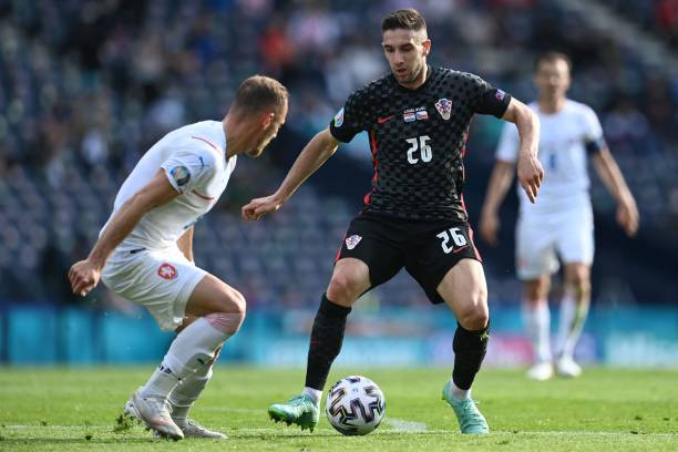 Croatia's midfielder Luka Ivanusec is marked by Czech Republic's defender Vladimir Coufal during the UEFA EURO 2020 Group D football match between...