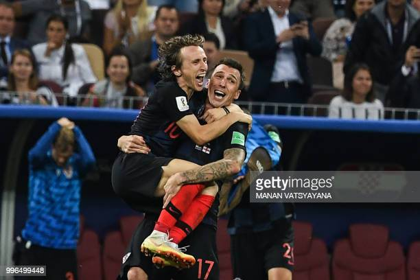TOPSHOT Croatia's midfielder Luka Modric and Croatia's forward Mario Mandzukic celebrate their win at the end of the Russia 2018 World Cup semifinal...